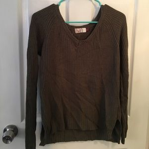 Women's olive green sweater.